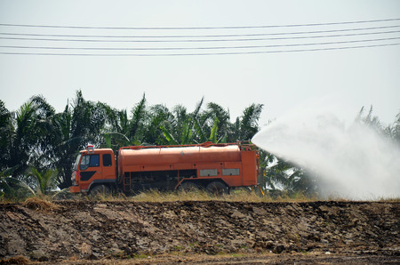 Water Truck spray to ground for protect occur dust at pond occur from excavation of the surface ground for Sale in Pathum Thani at Thailand photo