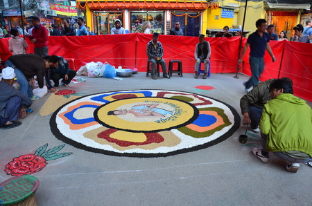 Nepalese people painting art from sand color for contest of Celebrating Tihar Deepawali festival at thamal market on November 2, 2013 in Kathmandu Nepal.
