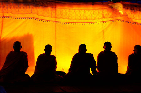 liturgy: Silhouette of Monk liturgy or pray for funeral at funeral ceremony in Thailand Stock Photo