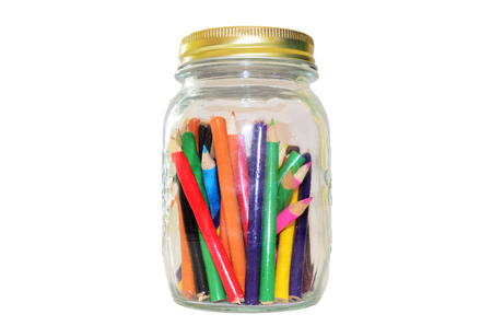 Colored pencils or crayon in widemouthed glass jar photo