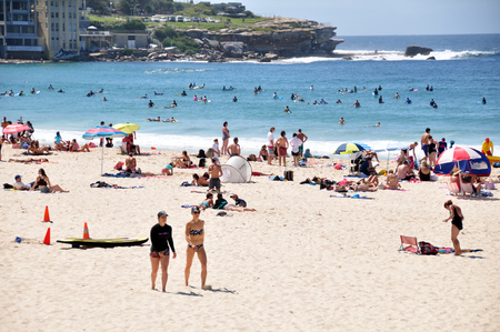 january 1: Traveler and Australian people come to Bondi Beach for relax and swimming or surfing at Sydney on January 1, 2015 in New South Wales, Australia.