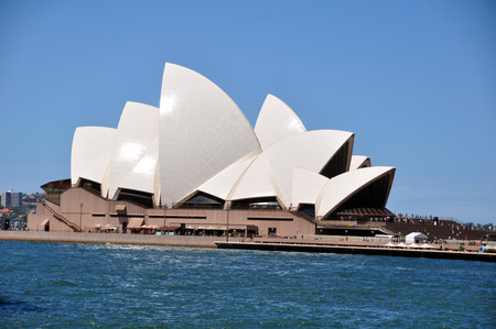 australian ethnicity: Sydney Opera House is a multi-venue performing arts centre at night time in Sydney, New South Wales, Australia.