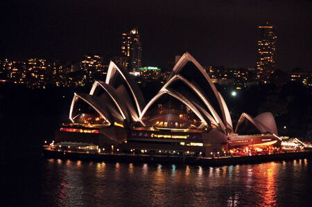 opera: Sydney Opera House is a multi-venue performing arts centre at night time in Sydney, New South Wales, Australia.
