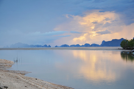 phangnga: Sunrise with sea and mountain in Fishing Village Bangpat Homestay at Phang-nga Thailand