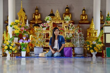Portrait Thai woman at Wat Phra Borommathat Chaiya Temple located in Chaiya district Surat Thani province in Thailand