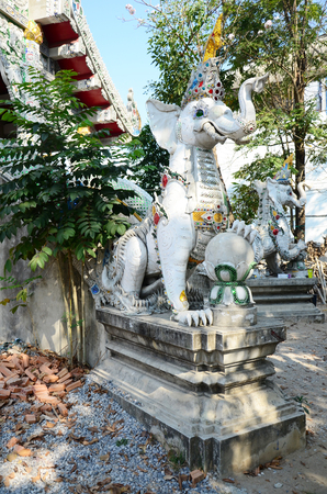 Carved and sculpture mythical creatures of Wat Ming Mueang Temple at Chiang Rai, Thailand photo