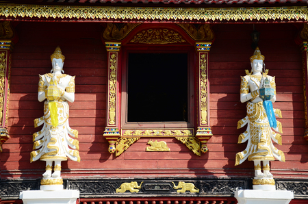 ming: Angel sculpture on the facade of Wat Ming Mueang at Chiang Rai, Thailand