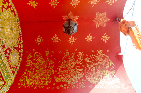 Art painting on ceiling of gate in Wat Ming Mueang at Chiang Rai, Thailand