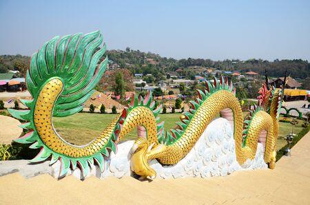 pla: Dragon at entrance of Chedi of Wat Huay Pla Kang Temple in Chiangrai, Thailand.