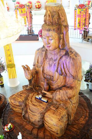bodhisattva: Carving Wooden Bodhisattva Goddess Statue or Guan Yin in Chinese culture at Wat Huay Pla Kang Temple on February 23, 2015 in Chiangrai, Thailand.
