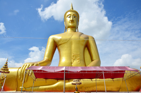 Golden Big Buddha statue image of Wat Bangchak Temple at Choapraya Riverside in Nonthaburi Thailand photo