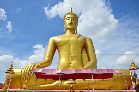 Golden Big Buddha statue image of Wat Bangchak Temple at Choapraya Riverside in Nonthaburi Thailand photo