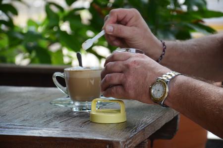 Drinking Hot Coffee in Garden photo