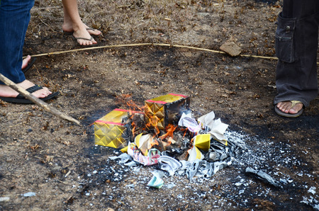 Burn joss paper or hell money Chinese Culture in The Qingming Festival at Sritasala Cemetery in Ratchaburi, Thailand. Stock Photo