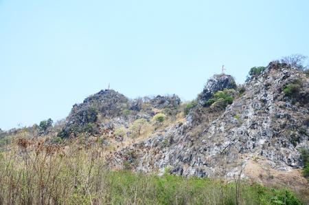 ratchaburi: Buddha Statue on top of mountain in Ratchaburi, Thailand. Stock Photo