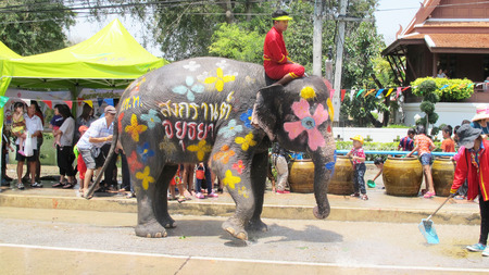 14 15 years: Songkran Festival is celebrated in a traditional New Years Day from April 13 to 15, with the splashing water with elephants on April 14, 2015 in Ayutthaya, Thailand.