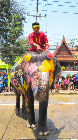 Songkran Festival is celebrated in a traditional New Years Day from April 13 to 15, with the splashing water with elephants on April 14, 2015 in Ayutthaya, Thailand.