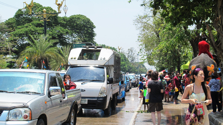 foreigner: Thai people and traveler foreigner join with Songkran Festival is celebrated in a traditional New Year is Day at ayutthaya road on April 14, 2015 in Ayutthaya, Thailand