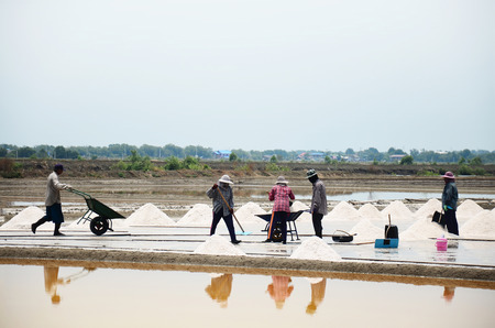 Thai people keeping salt from Salt farming or Salt evaporation pond to warehouse at Bangkhunthein on April 12, 2015 in Bangkok Thailand.