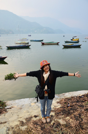phewa: Traveler thai women portrait at Phewa Tal or Fewa Lake in pokhara of Annapurna Valley Nepal