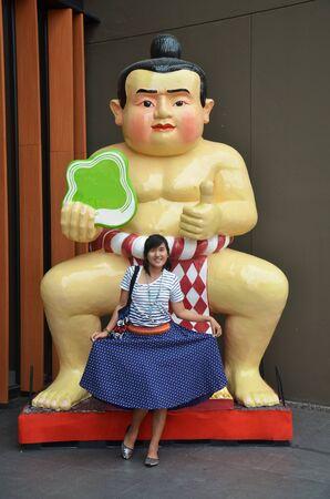 thai women: Thai women portrait with sumo doll Stock Photo