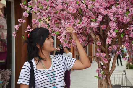 richly: Thai women portrait with richly blossoming cherry tree sakura flower