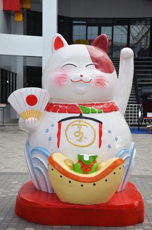 fortune cat: Japanese maneki neko lucky cat Stock Photo