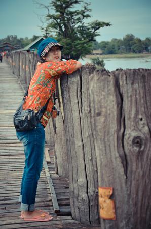 longest: Thai women travel on U Bein  Wooden longest Bridge in Amarapura Myanmar