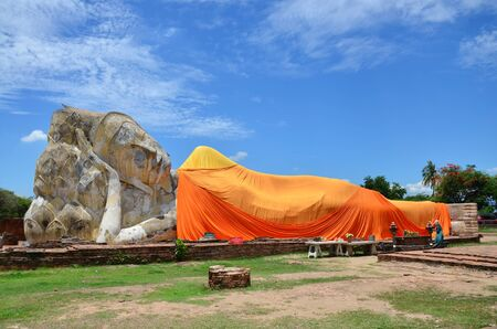 People come to Wat Lokayasutharam Temple for travel and pray Reclining Buddha on June 9 2015 in Ayutthaya Thailand. photo