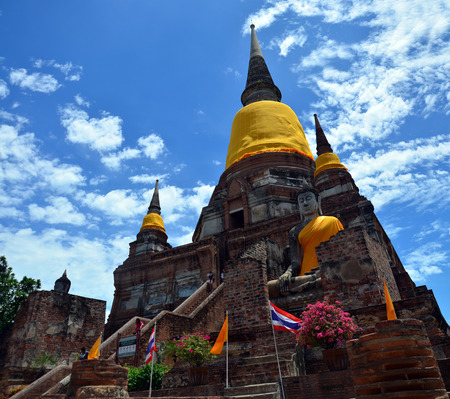 chaimongkol: Prang and Buddha Statue of Wat yai chai mongkhon in the city of Ayutthaya Thailand