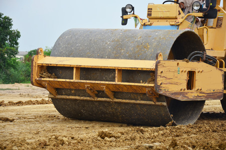 vibroroller: Road roller steamroller or vibratory roller on construction site