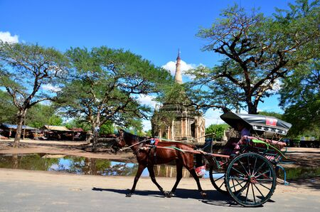 horse drawn carriage: Traveler use horse drawn carriage for travel around ancient city bagan Editorial