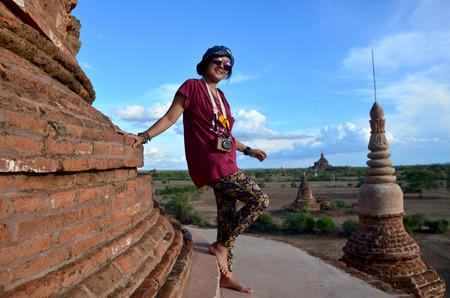 bu: Thai woman shooting photo Ancient City Bagan from top of Bu le thi Pagoda Stock Photo