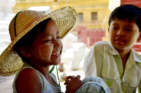 burmese: Burmese children smile while talk with traveler at Shwezigon Pagoda