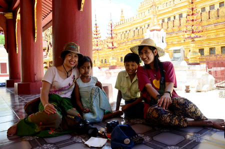 foreigner: Burmese children take photo with foreigner at Shwezigon Pagoda