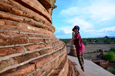 bu: Thai woman portrait on top of Bu le thi pagoda for wait sunset at Bagan Stock Photo