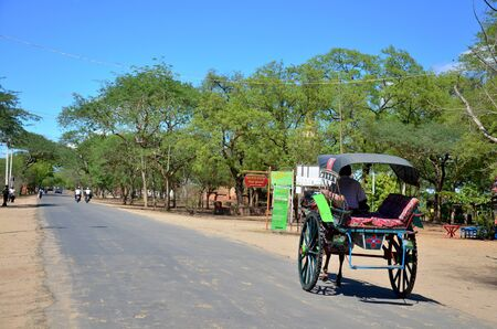 horse drawn carriage: Traveler use horse drawn carriage for travel around ancient city bagan at Archaeological Zone on May 20, 2015 in Bagan, Myanmar