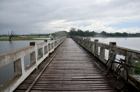 longest: U Bein Wooden longest Bridge in rainning time at Amarapura, Myanmar. Stock Photo
