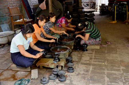 lacquerware: Burmese people working made Lacquerware burma style at Old Bagan on May 21, 2015 in Mandalay, Myanmar.