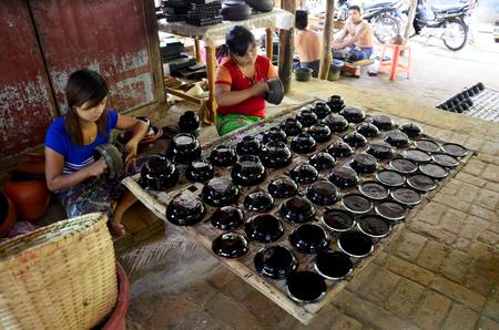 lacquerware: Burmese people working made Lacquerware burma style at Old Bagan on May 21, 2015 in Mandalay, Myanmar.