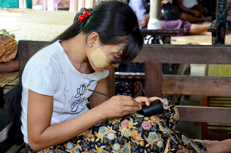 lacquerware: Burmese people carving Lacquerware burma style at Old Bagan on May 21, 2015 in Mandalay, Myanmar.