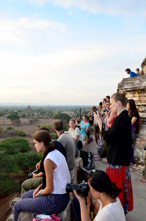 pagan: Traveler wait shooting photo sunrise at Ancient City with over 2000 Pagodas and Temples of Bagan (Pagan) Archaeological Zone on May 21, 2015 in Bagan, Myanmar.