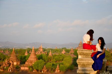 looking at view: Traveller looking view of Ancient City in Bagan (Pagan) Archaeological Zone, Myanmar with over 2000 Pagodas and Temples.