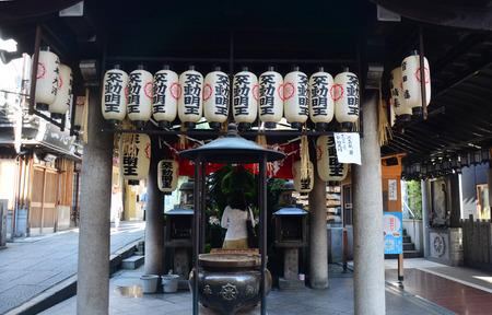 fulfilled: Thai women splash water, pray , and your wish will be fulfilled with Fudomyoo statue japanese style of Hozenji Temple at Hozenji Yokocho Alley in Osaka, Japan Editorial