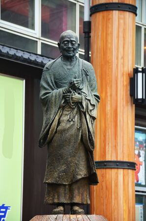 zen interior: Gyoki Bosatsu statue of a monk stands in front of a small fountain near the kintetsu Nara station in Nara, Japan.
