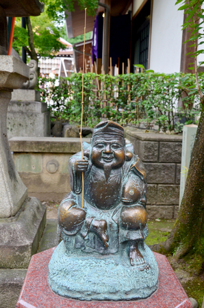 god: Ebisu statue god of fishers or merchants is the Seven Gods of Fortune, commonly referred to in English as the Seven Lucky Gods, are the seven gods of good fortune in Japanese mythology and folklore Editorial