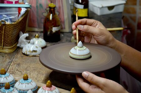 thai people: Thai people woking process paint Ceramic Benjarong is traditional thai five basic colors style pottery at workshop on August 8, 2015 in Samutsakhon, Thailand.