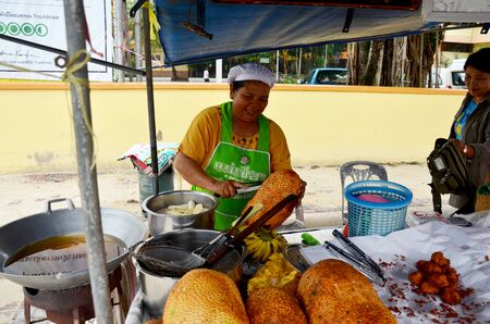 integer: Thai people peeling Champedak or Artocarpus integer sale for people at market on September 18, 2018 in Nakhon Si Thammarat, Thailand Editorial