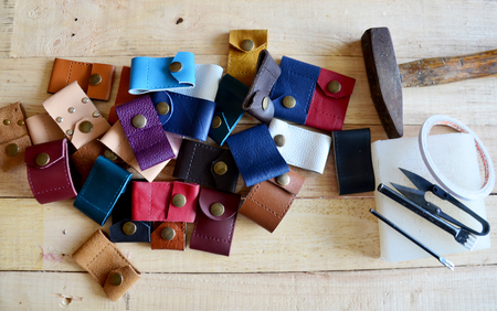 Leather craft tools for Handmade key ring and small bag made from leather Stock Photo