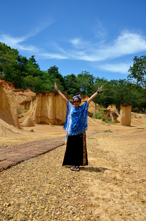 pee pee: Thai woman portrait and happy feeling at Phae Mueang Phi of Pae Mueng Pee Royal Park in Phrae, Thailand